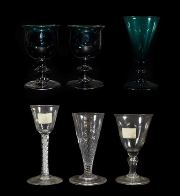 Lot 15 - A Pair of Green Glass Wine Glasses, early 19th century, the ovoid bowls with everted rims on...