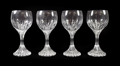 Lot 20 - A Set of Four Baccarat Wine Glasses, modern, Massena pattern, with fluted oval bowls, waisted stems