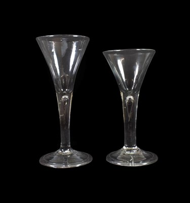 Lot 23 - A Wine Glass, circa 1750, the trumpet bowl on plain stem with air tear and folded foot, 18cm...