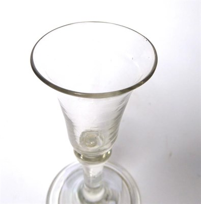 Lot 33 - A ''Gin'' Glass, circa 1760, the bell shaped bowl with basal ball knop on a plain stem and...