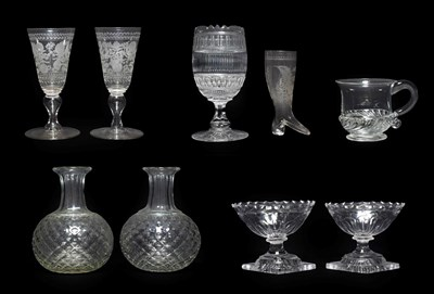 Lot 40 - A Pair of Regency Cut Glass Salts, circa 1810, of panelled boat form on lemon squeezer bases,...
