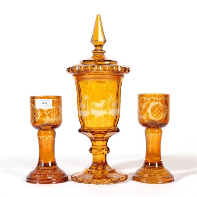 Lot 44 - A Bohemian Amber Overlay Clear Glass Goblet Vase and Cover, mid 19th century, the panelled bowl...