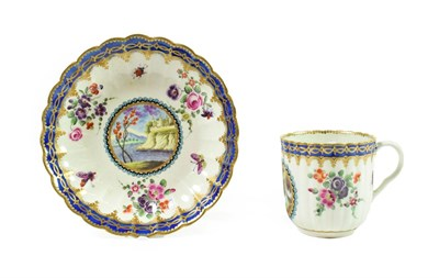 Lot 45 - A Worcester Porcelain Fluted Coffee Cup and Saucer of Dalhousie Type, circa 1780, each painted with
