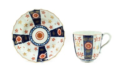 Lot 54 - A Worcester Porcelain Large Coffee Cup and Saucer, circa 1770, of fluted form, painted with the...
