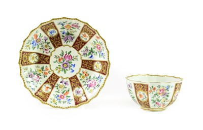 Lot 57 - A Worcester Porcelain Tea Bowl and Saucer, circa 1770, of fluted form, painted with sprays of...