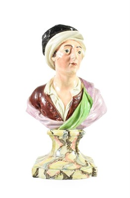 Lot 61 - A Pearlware Bust of Matthew Prior, circa 1800, naturalistically modelled wearing a black and...