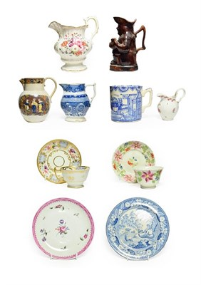 Lot 69 - An English Porcelain Teacup and Saucer, circa 1810, painted with flowersprays within blue panel...
