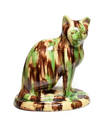 Lot 80 - A Slipware Model of a Seated Cat, possibly Canny Hill Pottery, Bishop Auckland, circa 1860, on...