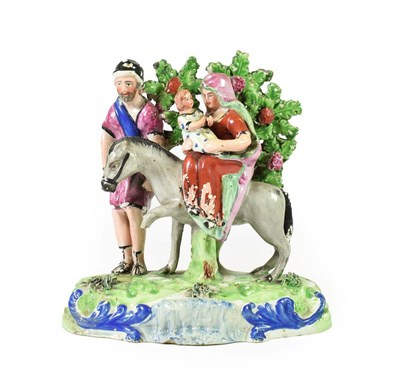 Lot 81 - A Walton Type Pearlware Flight to Egypt Group, circa 1820, modelled as the Holy Family with a...