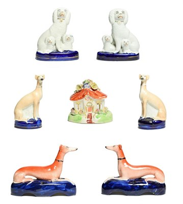 Lot 85 - A Pair of Staffordshire Pottery Pen Holders, late 19th century, modelled as recumbent greyhounds on