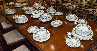 Lot 95 - A Wedgwood Earthenware Dinner Service, modern, decorated with the Napoleon Ivy pattern, printed...