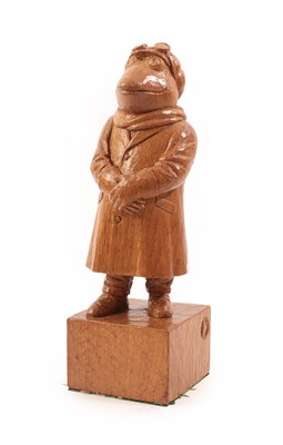 Lot 2093 - Workshop of Robert Mouseman Thompson (Kilburn): An English Oak Mr Toad, wearing a driving coat,...