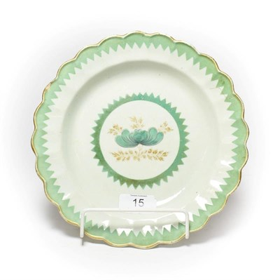 Lot 15 - An 18th century Worcester lobed plate, decorated with gilt and French green enamel with a saw tooth