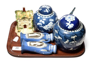Lot 20 - Two Chinese ginger jars and covers, a Chinese blue and white boat, a Staffordshire pastille burner