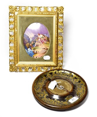 Lot 21 - A Victorian circular brass inkstand dish, with pen and a Continental porcelain plaque depicting...