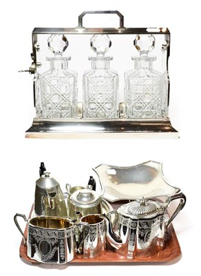Lot 27 - A Group of silver plate and pewter, including: an oblong tantalus with three cut-glass...