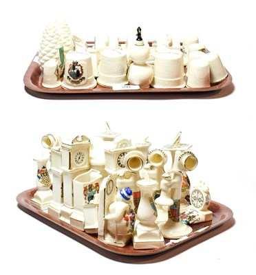 Lot 28 - Crested china to include thimbles, cheese dishes, sundials, stick telephones, longcase clocks...