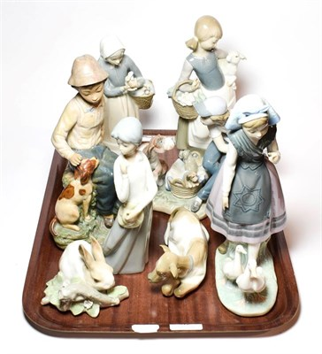 Lot 32 - Six Lladro figural and animal theme ceramics, and two others by Casades and Nao (8)