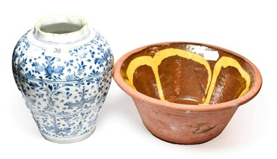 Lot 38 - An 18th century Delft vase 21.5cm, along with a slipware bowl, possibly 19th century (2)