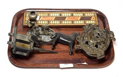 Lot 42 - A primitive carved wood horse and cart, a cast iron money box, a cribbage board, a candlestick with