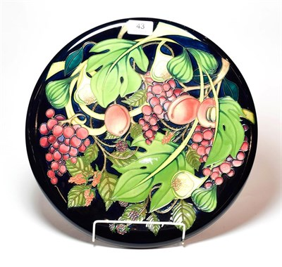 Lot 43 - A Moorcroft Queen's Choice pattern charger, designed by Emma Bossons, 35.5cm diameter.