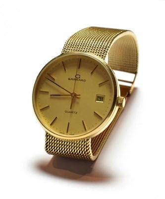 Lot 45 - A 9 carat gold Garrard wristwatch, with a Garrard box