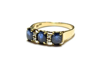 Lot 48 - A sapphire and diamond ring, stamped '585' and '14K', finger size Q1/2