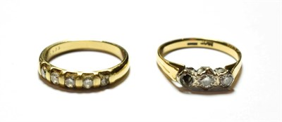 Lot 49 - A diamond five stone ring, stamped '9K', finger size L1/2; and a diamond three stone ring,...