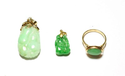 Lot 51 - A jade ring, stamped '14K', finger size Q1/2; and two jade type pendants