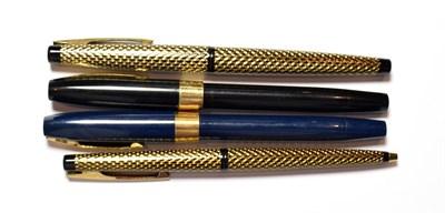 Lot 54 - Three Sheaffer fountain pens and a ballpoint pen