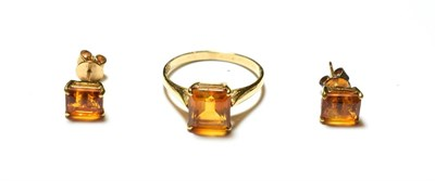 Lot 57 - A citrine ring, stamped '9K', finger size Q1/2; and a pair of matching earrings, unmarked