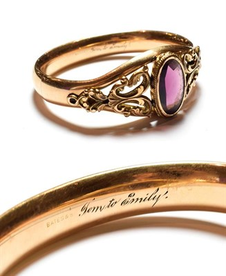 Lot 59 - A Victorian gilt metal purple glass hinged bangle, inner measurements 6.3cm by 5.3cm