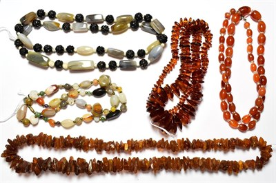 Lot 62 - A chalcedony bead necklace, length 76cm; two irregular shaped amber bead necklaces; and two further