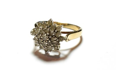 Lot 64 - A 9 carat gold diamond cluster ring, finger size S