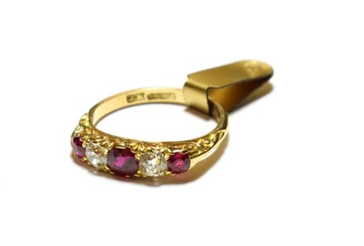 Lot 68 - A synthetic ruby and diamond five stone ring, three graduated round cut synthetic rubies...