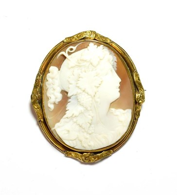 Lot 76 - A shell cameo depicting a maiden in a yellow metal frame, measures 6.4cm by 5.5cm