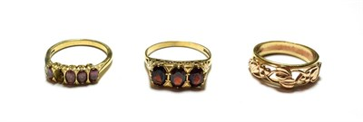 Lot 78 - Three 9 carat gold rings including two garnet examples, various designs and finger sizes (one a.f.)