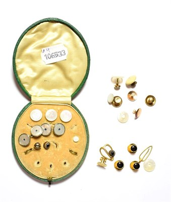 Lot 83 - A selection of studs, including a cased set of four gilt metal studs, a pair of mother-of-pearl...