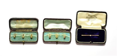 Lot 84 - A set of three dress studs, two hallmarked for 9 carat gold and one stamped '18CT', cased; a set of