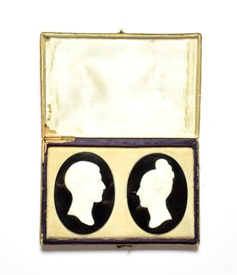 Lot 87 - Two oval jet plaques applied with cameos in profile, cased