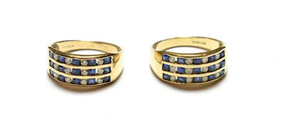 Lot 90 - A pair of 9 carat gold sapphire and diamond rings, formed of three rows of five calibré cut...