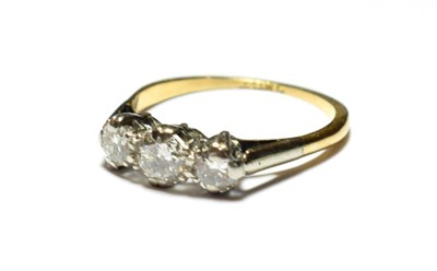 Lot 93 - A diamond three stone ring, the graduated round brilliant cut diamonds in white claw settings, to a