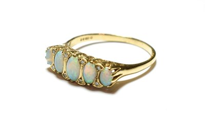 Lot 94 - A 9 carat gold opal ring, the five graduated oval opals with eight cut diamond accents, to a...