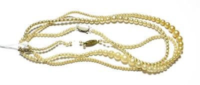 Lot 95 - Three graduated simulated pearl necklaces, various lengths