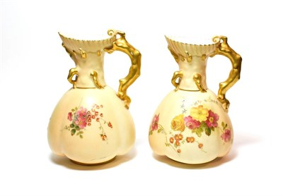 Lot 97 - A pair of Royal Worcester blush ivory ewers, 16.25cm.