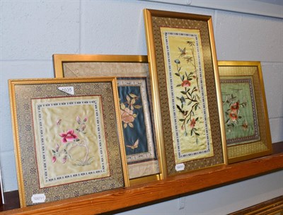 Lot 1035 - Four Oriental embroidered silk panels (framed)