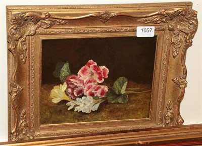 Lot 1057 - British School, 19th century, Still life of flowers on a mossy bank, oil on canvas