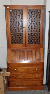 Lot 1065 - A modern oak bureau bookcase with leaded glass upper section, 84cm by 28cm by 185cm
