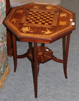 Lot 1080 - A late Victorian parquetry decorated occasional table with foliate and bird decoration on...