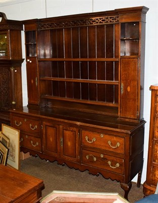 Lot 1085 - A George III checkered inlaid oak dresser and rack, the upper section with pierced fretwork,...